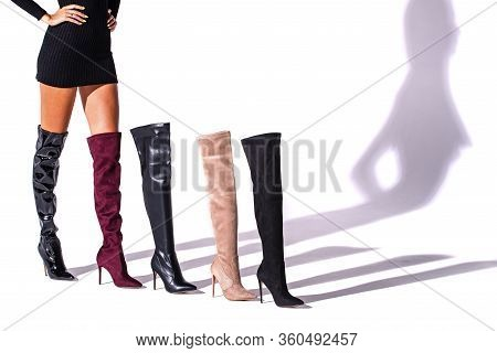 Black Hessian Boots On The Legs Of The Model On A White Background With Shadows And Other Hessian Sh