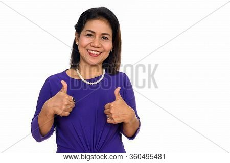 Studio Shot Of Happy Mature Asian Woman Giving Thumbs Up Isolated Against White Background