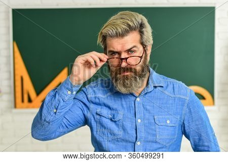 Serious Bearded Teacher In Glasses. Back To School. Develop Logic And Creativity. Start The Brain En