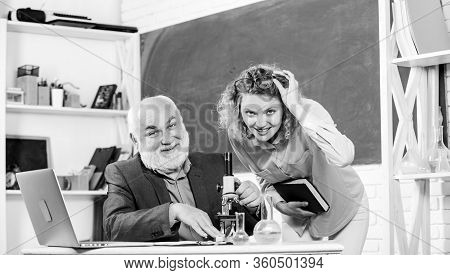 Biological Research. Teacher And Girl With Notepad Near Chalkboard. Biology Science. Study Biology.