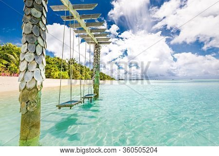 Exotic Tropical Paradise Landscape With Swings Over Crystal Clear Turquoise Blue Ocean Sea Water Lan