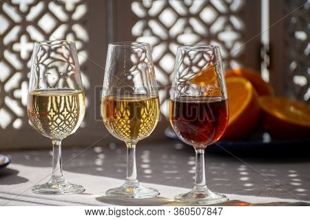 Glasses With Cold Dry Fino And Sweet Cream Sherry Fortified Wine In Summer Sunlights, Andalusian Sty