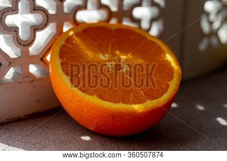Fresh Ripe Orange Citrus Fruit And Andalusian Ornament On Background Close Up