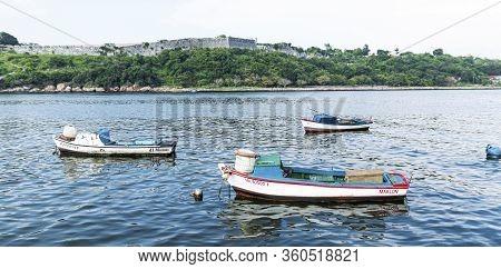 Havana, Cuba - 25 July 2018: Three Small Fishing Boats Are Moored Off Of Melecon Road With El Morro