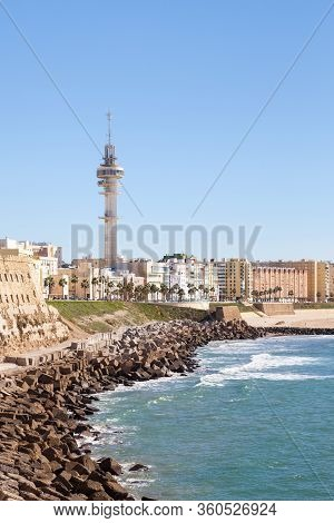 The Beach Of Santa Maria Del Mar.  Cadiz Waterfront In Spain And The View Along The Beach Of Santa M