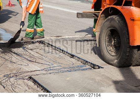 Workers On Asphalting Paver Machine During Road Street Repairing Works. Street Resurfacing. Fresh As
