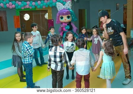 Childrens Birthday Party With Lol Animators. Happy Group Of Children At A Birthday Celebration Dress