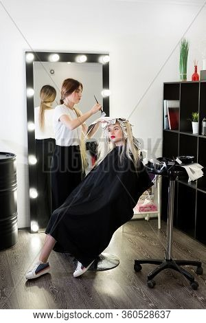 Process Of Dyeing Hair At Beauty Salon.
