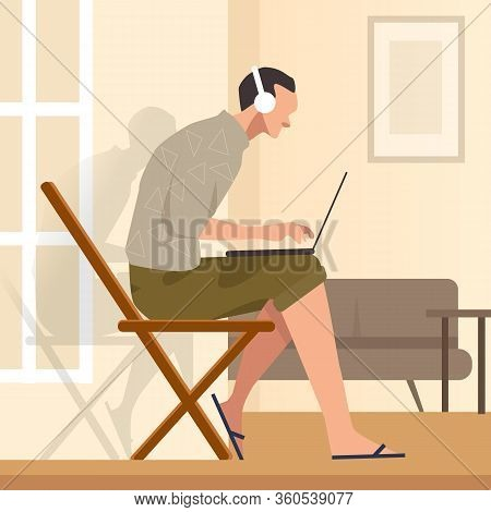 Working From Home Sitting In Chair While Looking At The Laptop Screen And Listening To Headphones