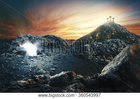 Easter Sunday Concept: Empty Tomb Stone With Cross On Meadow Sunrise Background. 3d Rendering
