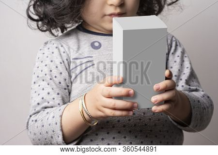 Little Girl  Holding A Small Cubical Box In Hands, Box Template Ready For Replacing Your Image-clipp