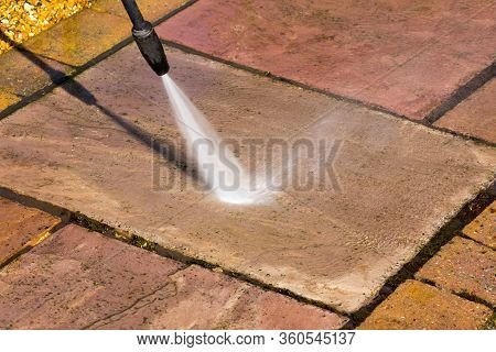 Close Up Of A Pressure Washer Cleaning A Stone Slab