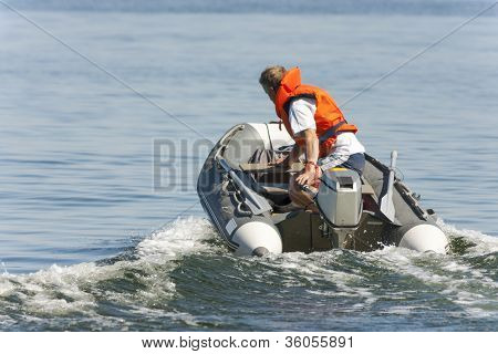 Man Driving On A Boat