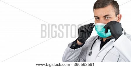 Caucasian Man Posing As A Medical Doctor In White Overall Or Scrub With Stethoscope Around A Neck An
