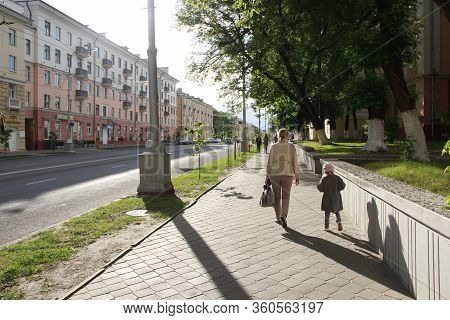 Gomel / Belarus - May 20, 2018 :  People Walk Through City. Mother Going With Dauthter Along The Str