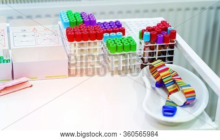 Many Test Tubes For Blood Testing. Medical Equipment. Tubes For Analysis In The Laboratory Of Hemato
