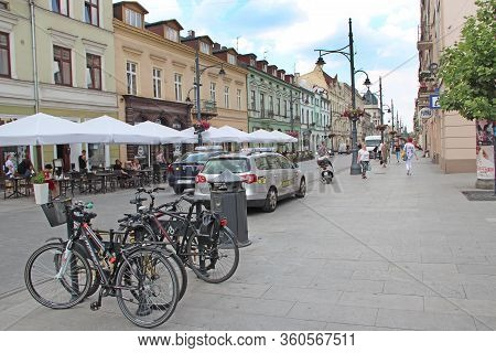 Lodz / Poland. 18 July 2019: View Of City Street With Many Bicycles. Bicycles Parked In Rental Parki