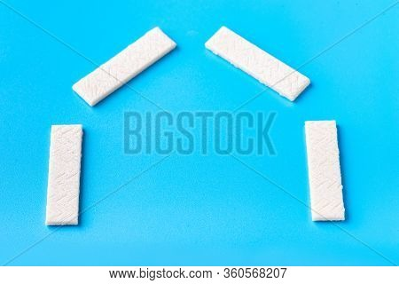 Chewing Gum On A Blue Background That Can Be Used For Lettering. Chewing Gum Is Laid Out In The Shap
