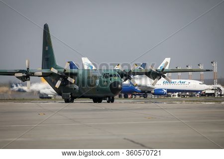 Otopeni, Romania - April 9, 2020: Lockheed C-130 Hercules Military Cargo Plane Of The Romanian Air F