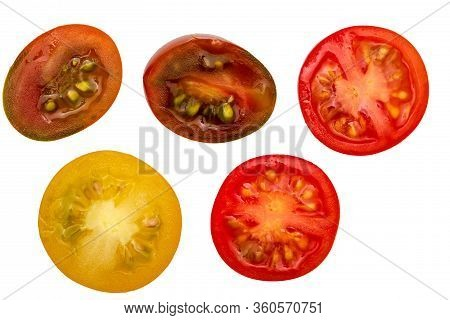 Fresh And Raw Cherry Tomatoes (red, Maroon And Yellow), Cut In Half. With Water Drops Isolated On Wh