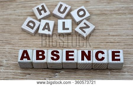 Concept Of The Word Absence On Cubes On A Light Wooden Background