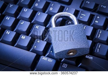 Cyber Security Concept Closed Padlock On The Computer Keyboard. Cloud Data And Work From Home Secure