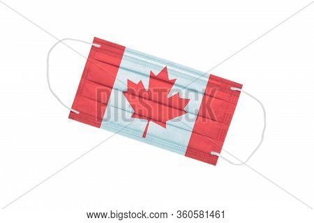 Medical Face Mask With Canada Flag On The Front Side Isolated On A White Background. Canada Pandemic