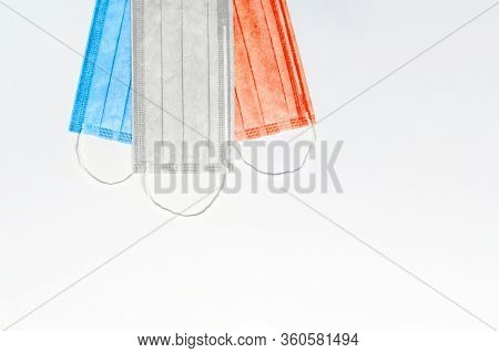 Three Medical Masks Of Blue, White And Red Are Located At The Top On A Light Background. Flag Of Fra