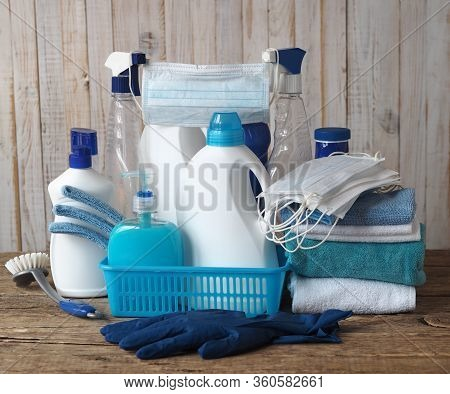 Disinfection And Protection Against Coronavirus Infection. A Medical Mask On Plastic Bottles From A