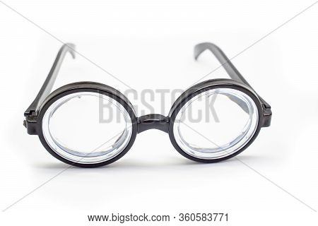 Of Poor Vision. Funny. Isolate On White Background. Round Black Rimmed Glasses With Thick Lenses.