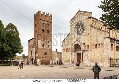 Verona, Italy - September 27, 2015 : Few Tourists And Passersby Walk Near The Basilica Di San Zeno M