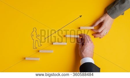 Business Teamwork And Cooperation Conceptual Image - Male And Female Hands Making A Stairway Of Wood