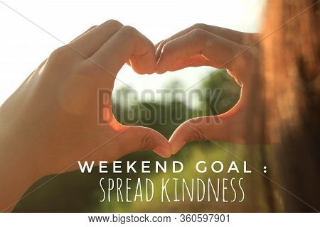 Inspirational Motivational Quote - Weekend Goal, Spread Kindness. With Young Woman Hands Making Hand