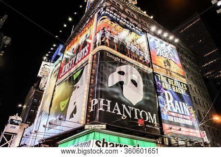 Manhattan, Ny - July 10, 2011: Night Scene Of Broadway At Times Square In Manhattan, New York City W