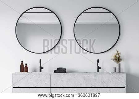 Comfortable Stone Double Sink With Two Round Mirrors Standing In Modern Bathroom With White Walls. 3