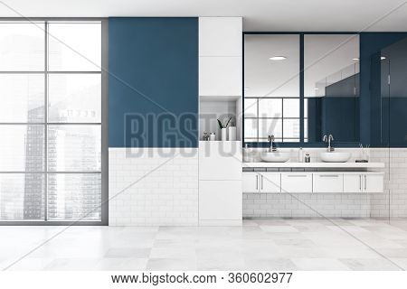 Interior Of Modern Bathroom With Blue And White Brick Walls, Tiled Floor, Comfortable White Double S