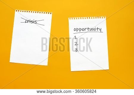 A Sheet Of Paper With A Crossed Out Word Crisis And A Sheet Of Paper With The Inscription Opportunit