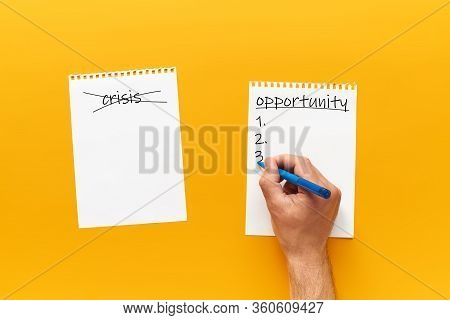 Male Hand Crossed Out The Crisis And Writes The Word Opportunity. Concept Of Personal Choice And New