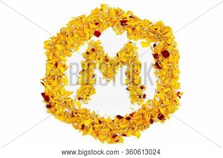 Letter M In Spring Flower Petal Hexagon. Marigold Petal Alphabet Isolated On White Background.