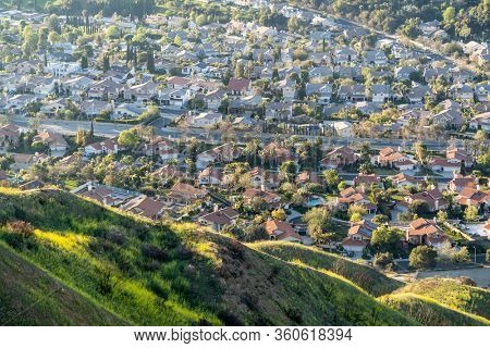 Mountain slopes and valley homes in the Granada Hills area of north Los Angeles, California.