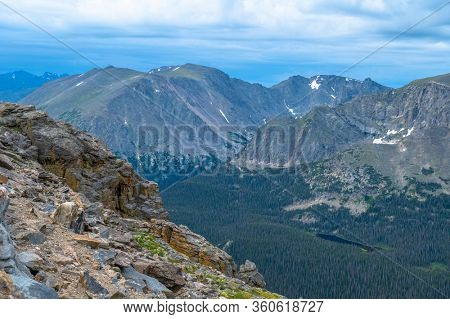 Scene of the Rocky Mountains in Colorado on a cloudy afternoon