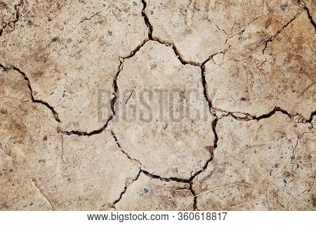 Natural Dirty Mud Ground Texture Background. Closeup Macro Of Dry Brown Soil Sand Land. Abstract Ear