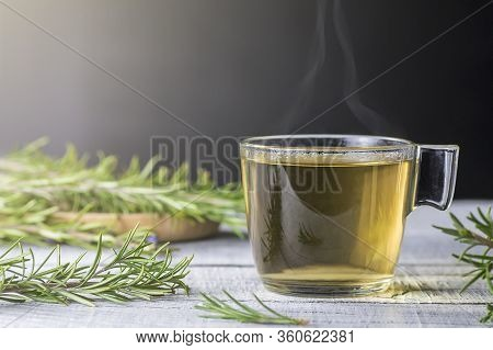 Cup Of Healthy Rosemary Tea With Fresh Rosemary Bunch On Rustic Background, Winter Herbal Hot Drink