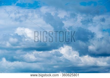 Cumulonimbus  Clouds On A Summer Blue Sky. Time Before A Thunderstorm. Abstract Background