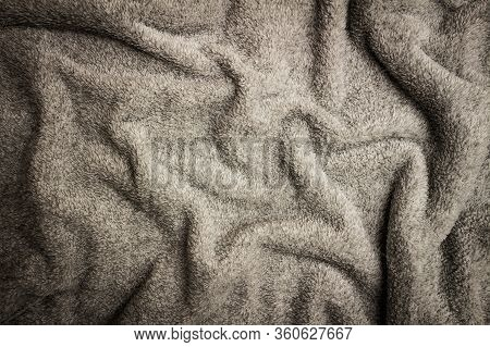 Gray Crumpled Bedspread Texture For Background With Black Vignette. Close-up Of Natural Warm Wool Co
