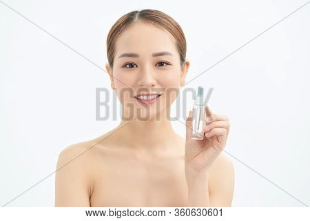 Beautiful Young Asian Woman Showing Skin Care Product Isolated On White Background.