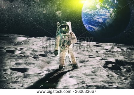 Astronaut On Moon Surface With Space Background. Elements Of This Image Furnished By Nasa