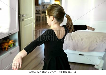 Schoolgirl Doing Sports Exercises - Gymnastics, Choreography. Stay At Home. Concept Of Self Isolatio