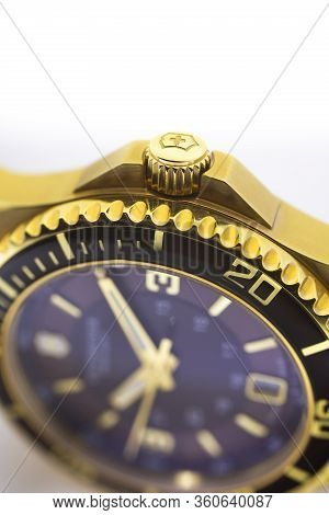 Ibach, Switzerland 31.03.2020 - The Close Up Of Victorinox Man Watch Stainless Steel Case Gold Pvd C