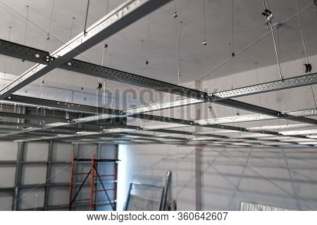 The Installation Of Suspended Ceiling At The Construction Site